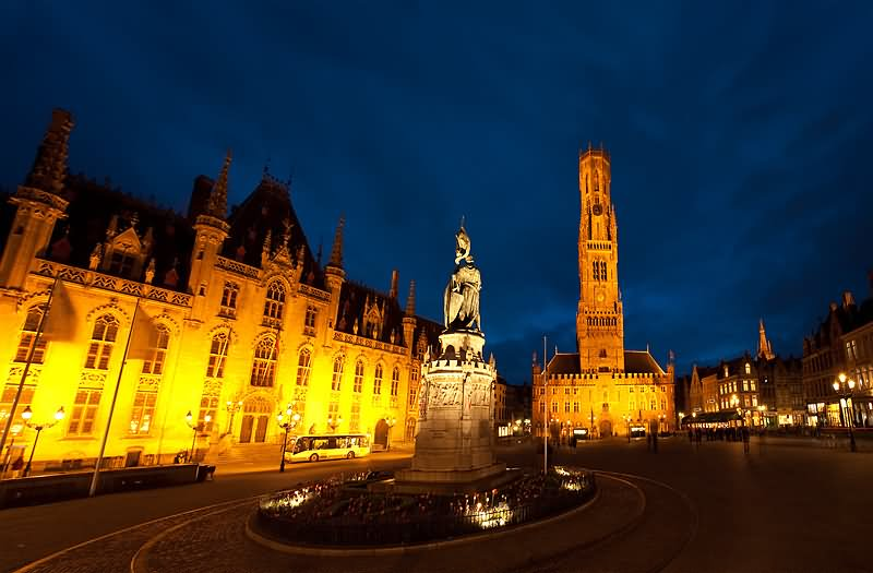A-Statue-In-Grote-Market-In-Front-Of-The-Belfry-of-Bruges-In-Belgium